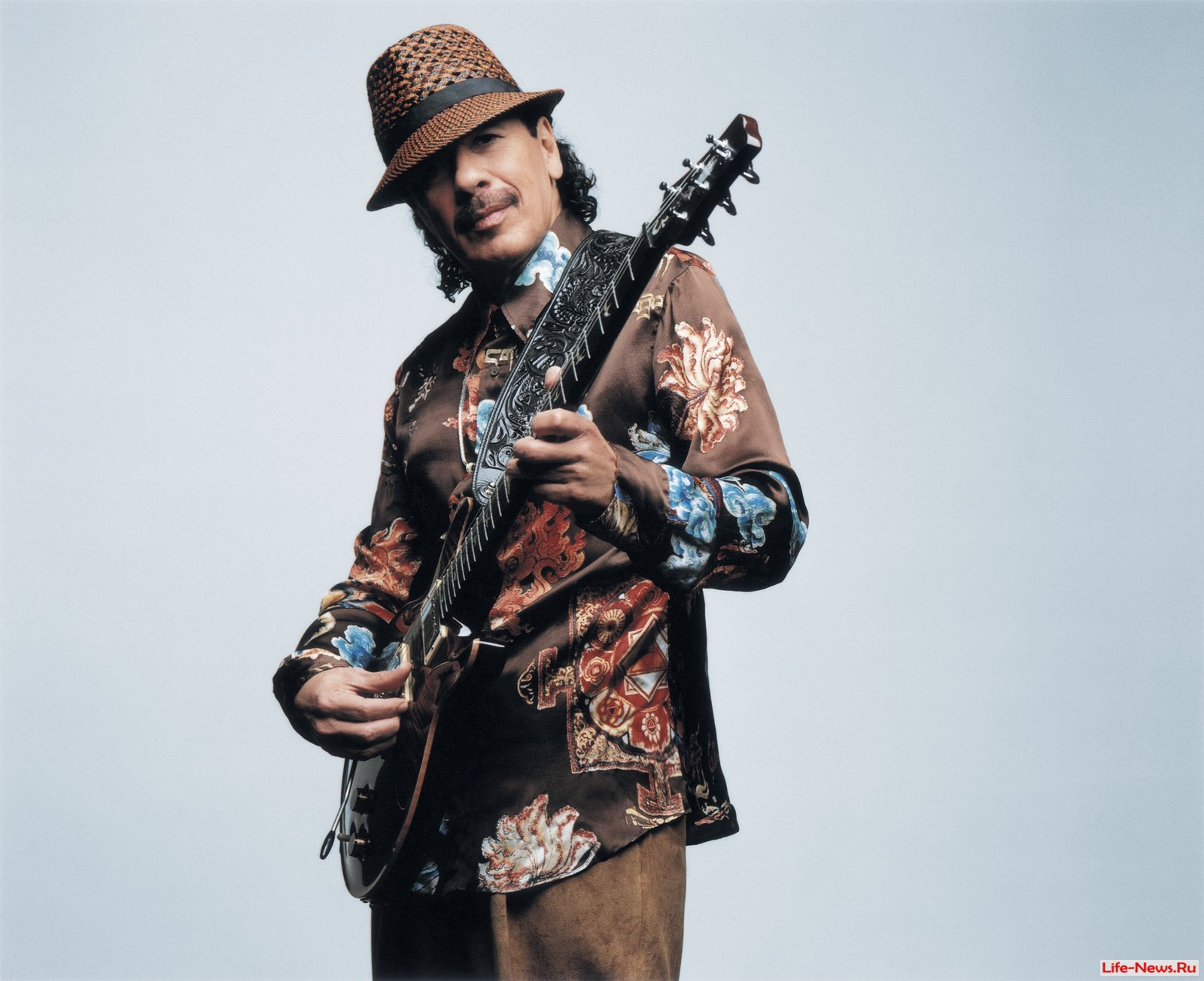a biography of carlos santana a world famous rock icon As carlos santana hits his 70th birthday, the icon shows no signs of who is best known for combining his mexican roots with a rock beat in.