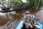 Начались материальные выплаты пострадавшим от разрушительного паводка